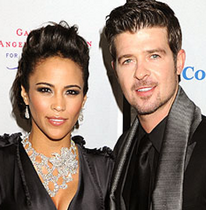 A 20 year old girl alleges that she had an affair with Robin Thicke while Paula Patton was present.